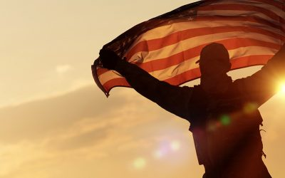 A Soldier waving the American Flag